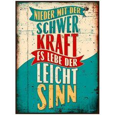 """Schild mit Spruch: """"Nieder mit der Schwerkraft - es lebe der Leichtsinn!"""". Schnelle Lieferung aus der Schweiz. 100% Zufriedenheit."""