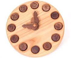Wooden Learning Clock from The Original Tree Swing Teaches Kids to Tell Time This.