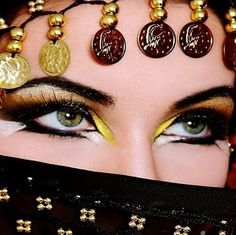 Gypsy-inspired style.  Check out our gypsy head scarves and face veils on www.bellydance.com