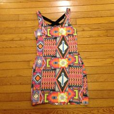 NOLLIE PACSUN MULTICOLORED AZTEC BODYCON DRESS Adorable NOLLIE dress. Aztec print. Adorable cross cross back. Size small Nollie Dresses
