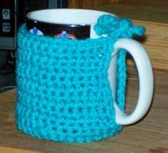 Crocheted coffee mug cozy! ok... i need this. and perhaps so do my coffee lovin' friends and family! Christmas gifts? perhaps!