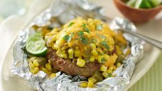 Green Chile Cheddar Burger Foil Packs- Reimagine burgers on the grill with this flavorful dinner that brings together classic cheeseburgers, a zip of green chiles and craveable corn salsa. Foil Packet Dinners, Foil Pack Meals, Foil Dinners, Foil Packets, Grilling Recipes, Beef Recipes, Cooking Recipes, Grill Meals, Grilling Ideas