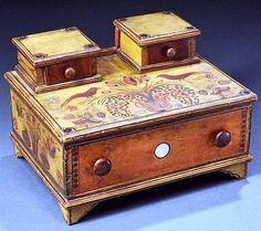 Fancy Paint-decorated Lady's Sewing Box, probably Pennsylvania, c. 1830, with two small cased drawers on a large cased drawer with applied molding, supported on shaped bracket feet, painted yellow