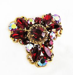 Hey, I found this really awesome Etsy listing at https://www.etsy.com/listing/156220465/regency-red-and-red-ab-brooch-pendant