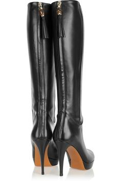 Leather knee boots.