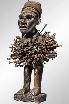 Africa | Nkisi power figure from DR Congo | Wood, nails, textiles