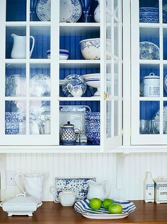 Painted blue cabinet interiors show off a collection of Chinoiserie beautifully.