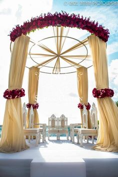 Gold Mandap with red floral.