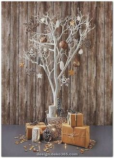 Christmas cheer: all present and correct – in pictures, Christmas tree decorations, Unusual Christmas Trees, Elegant Christmas Decor, Christmas Tree Branches, Alternative Christmas Tree, Wooden Christmas Trees, Outdoor Christmas, Rustic Christmas, Simple Christmas, Christmas Home