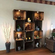 Ahh!  So pretty with the stain and those lights!  Wooden crates decorted as a wall unit