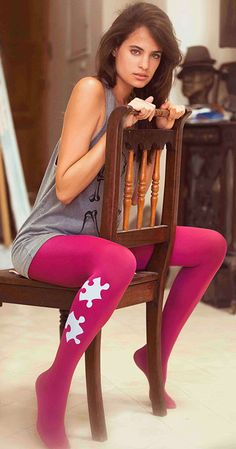 Turn heads with these eye - catching brights pink Puzzle Print Tights by Zohara