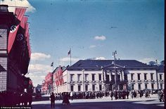 Rally: Soldiers and civilians at a rally on the decorated streets in Berlin. This photo is believed to have been taken on Labour Day (May 1) in 1937