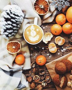 Spiced Everything At Christmas - Dried Oranges And Nuts Laid On A Rustic Wooden Table