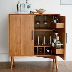 No more shoving your bottles of alcohol into your pantry shelves! This stylish bar cabinet is as chic as it is practical. It will store most of what you register for, and add character to your living or dining room.   West Elm Mid-Century Bar Cabinet - Small #weddingregistry