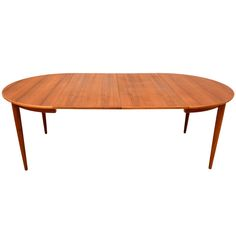 Danish Modern Teak Oval Dining Table   From a unique collection of antique and modern dining room tables at http://www.1stdibs.com/furniture/tables/dining-room-tables/