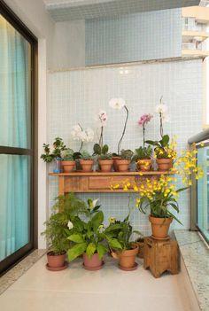 (2015) Apartamento Santa Rosa: Jardins rústicos por Escritório Ana Meirelles