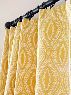 The same fabric from the kitchen window is used again in the eating area to create cohesiveness between the two areas. The curtains bring color and pattern to an otherwise neutral space. Curtain Patterns, Curtain Designs, Home Curtains, Curtains With Blinds, Yellow Dining Room, Yellow Curtains, Cotton Curtains, Curtain Fabric, Oak Kitchen Cabinets