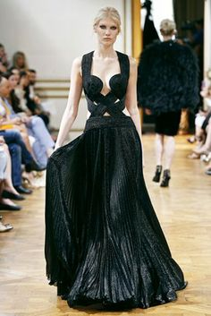 Long dress in black lamé crepe Georgette, bustier in iridescent twists and pleated skirt