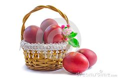 Three Easter eggs, painted in red, are beautifully decorated with wicker basket. Presented on a white background.