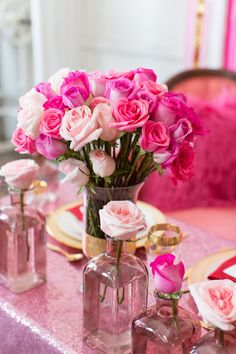 Pink vintage glass bottles provide the perfect vases for these gorgeous pink roses! *Paisley & Jade vintage & Eclectic Furniture Rentals for Events, Weddings, Theatrical Productions & Photo Shoots*