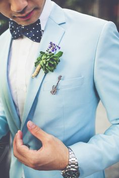 Light blue suit for groom. Love the guitar pin on his pocket.