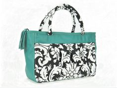 Acanthus tote of durable indoor/outdoor, black and white acanthus print with bright teal green genuine leather