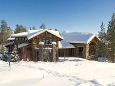 Fully constructed of stone and timber, this Teton Village lodge home sits perfectly on the slopes of Jackson Hole Mountain Resort. Inside, massive stone walls create division without taking away from the [m