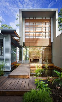 Great definition of 'entry' and 'threshold' - both are ideas worth exploring and expressing when you arrive at a house, to get a sense of definition between the public, outside world, and the inside, more private home.  Crossing the water via the bridge into a screen space is a beautiful transition between public and private.  House in Peachester, Qld by Tim Stewart Architects
