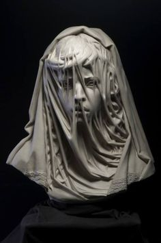 Child Bride, 2014, by Philippe Faraut  This sculpture was created to bring social awareness to the plight of the 15 million girls who are married each year before the age of 18. This young girl's expression of fear is barely hidden by her veiled face.