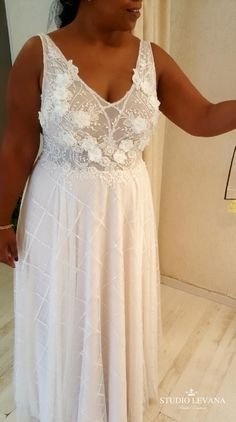 Plus size fashion forward lace gown with 3d florals. Tal. Studio Levana
