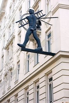 Vienna - shop sign - man with ladder. This is outside a very famous restaurant serving the best wienerschnitzel in town....I think it's called The Chimney Sweep in German that is...