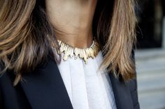love this necklace on top of a high neck blouse