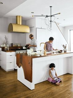 • crazy brass hood • waterfall wood counters