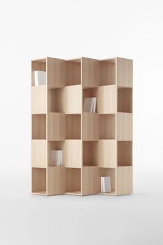 Shelving unit of interlocking wooden boards which fit together so seamlessly it is almost impossible to tell how the parts are connected by Conde House via nendo
