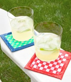 Don't spend your valuable paycheck on coasters. instead, flatten some straws and use duct tape for these unique DIY coasters.
