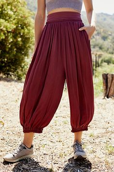 Perfect for lounging around or wearing to and from your workout, these gauzy harem pants feature a high waist and a cropped length with cuffed hems and a flowy fit.SizesXS, S, M, LMaterial & Fabrics rayonCleaning & CareHand wash cold Heram Pants, Loose Pants, Boho Pants, Harem Pants Outfit, Drape Pants, Trousers, Jumpsuit Pattern, Jacket Pattern, Harem Pants Pattern