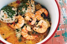 Moqueca capixaba                  We usually encounter only one version of Brazil's signature dish in this country — the one from Bahia, rich and almost currylike with…