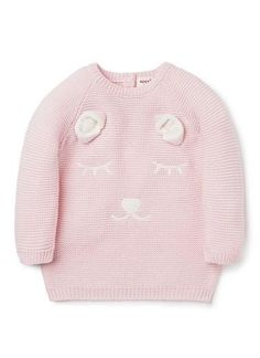 100% Cotton Sweater. Fully fashioned knit sweater. 1x1 rib trims on neck, cuffs and hem. Buttons on babys back for easy dressing. Features embroidered bear with novelty ears on front. Available in Ice Pink.