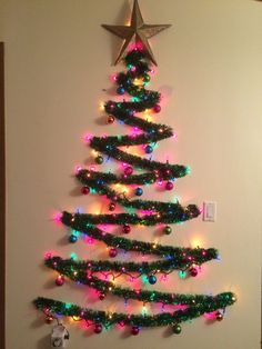 ideas lighting ideas diy wall christmas trees for 2019 Artificial fir tree as Christmas decoration? A synthetic Christmas Tree or perhaps a real one? Wall Christmas Tree, Creative Christmas Trees, Diy Christmas Lights, Rustic Christmas, Simple Christmas, Christmas Crafts, Christmas Ornaments, Christmas Christmas, Alternative Christmas Tree