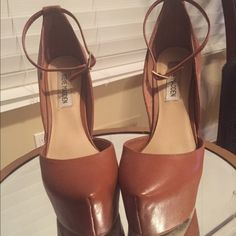 "Camel brown platforms! Camel brown leather platform pumps with ankle strap!  Super sexy and high without the pain because the platform provides support.  The heel is 5-1/4"" high.  Only worn twice. Steve Madden Shoes Platforms"