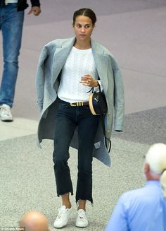 Here comes the bride! Alicia Vikander is pictured at Miami airport on Wednesday showing of...
