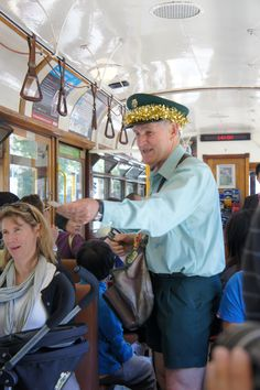 Ticket inspector on old tram in Melbourne. He was handing out grotty sweets. Adorable, slightly creepy