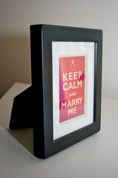 """Limited Edition """"Keep Calm and Marry Me"""" Romantic Ways To Propose, Surprise Date, Metal Frames, Proposal Ideas, Marry Me, Blue Backgrounds, Black Metal, Rugby, Framed Artwork"""