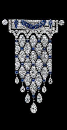 Boucheron - An early Art Deco platinum, diamond and sapphire brooch, French, circa 1910. #Boucheron #ArtDeco