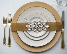 Metallic Wedding Decor.  Elegant charger plate in gold. Entertain in style at your dinner parties, weddings, holiday table, and so much more with this lovely gold serving plate that will give your events a glam look for less!  Find this charger in silver and gold at Afloral.com.