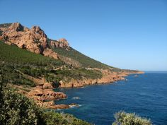 Esterel Mountains, Cannes - This volcanic massif located on the shores of the Mediterranean Sea is a must-see, whether by drivng, hiking, or both. Provence, Mediterranean Sea, Travel Planner, France, Hiking, Mountains, Water, Outdoor, Olive Oil