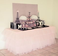 Parisian sweet table, featuring our tulle ruffled tablecloth.