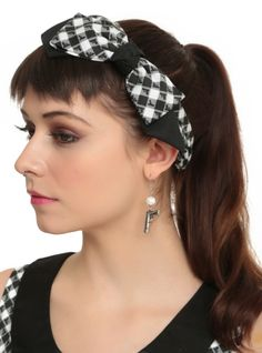 Alison inspired stretch headband from Hot Topic exclusive collection with a black and white gingham revolver and glue gun print and bow accent.