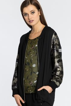 "Navigate the urban jungle in this edgy on trend bomber jacket with camo sleeves. Soft and easy to wear this piece is a great piece to travel in. Features: - Woven and knit combo - Camo knit sleeves - Zip front - Badge emblem on sleeve - Side pockets - Chiffon hood - Draw cord hem line - Slight hi lo hemline - Unlined Size & Fit: - Easy fit - Our model's height is 175cm (5' 9"") (some garments have been lengthened to accommodate models height) Fabric Compo..."