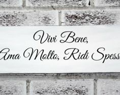 """Italian saying sign """"Live Well, Love Much, Laugh Often"""" in Italian"""